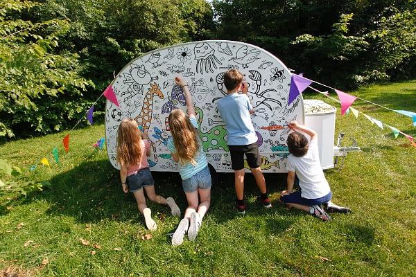 Eggnogg Colour-in Caravan - exterior - 4 kids colour in back of caravan