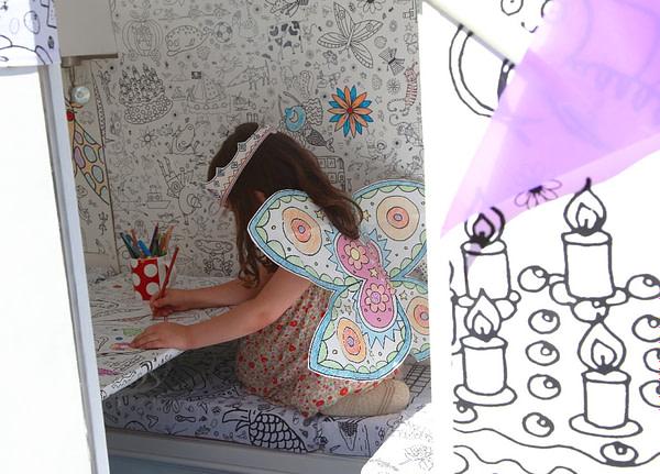 Eggnogg Colour-in Caravan - girl colours in tablecloth inside caravan